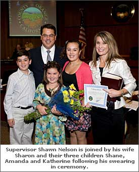 Supervisor Shawn Nelson is joined by his wife Sharon and their three children Shane, Amanda and Katherine following his swearing in ceremony.