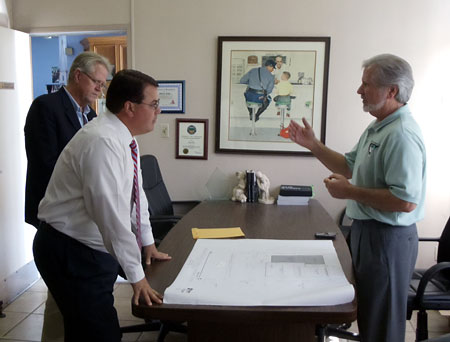 Above, Supervisor Nelson is discussing the expansion plans with Rick McCauley and Bruce Hird.