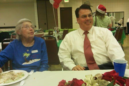 Supervisor Nelson takes a break at the Buena Park Senior center after serving food at their holiday party