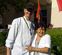 Chef Kemp Ponder gets a hug of appreciation from Evelyn Patino.