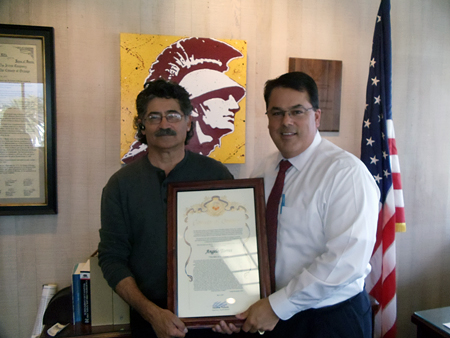 Supervisor Nelson presenting a Certificate of Recognition to Angelo Torres.